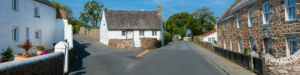 Street and Houses in village of Castel, Guernsey, Channel Islands, UK on summer day.